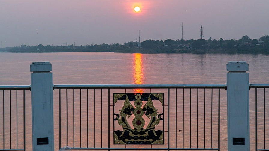 Beyond the Mekong river lies the timber-rich Laos.
