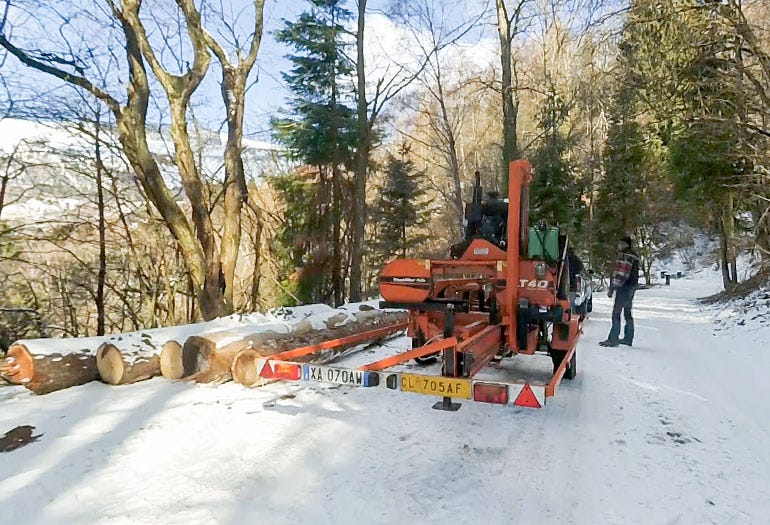 The sawmill is towed by a car