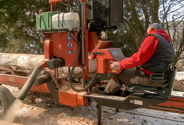 Operator sits in a comfortable chair while sawing